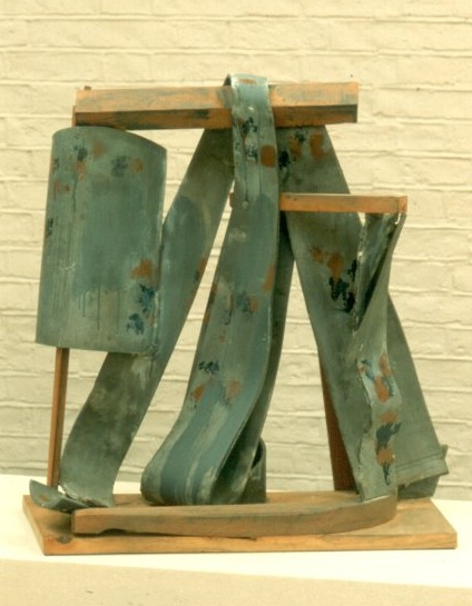 On the Up (1981), Lead & wood, painted, 63.5 x 58.5 x 21.5cm
