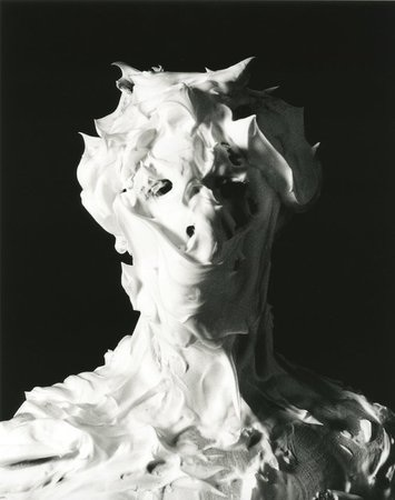 One of the grid of 24 self-portraits masked in shaving foam that make up Marcus Coates' British Moths, 2011