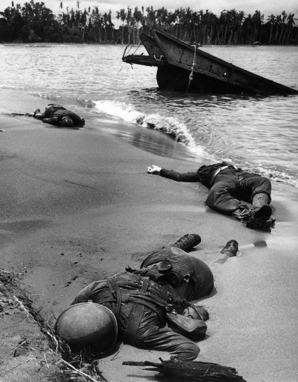 "<b>Caption from LIFE.</b> ""Three dead Americans on the beach at Buna."""